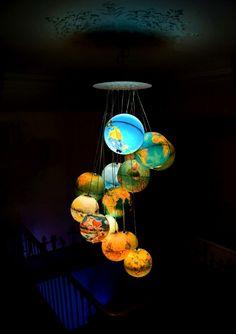 Monde à l'endroit, Monde à l'envers -- light fixture made from 15 vintage globes. I have four . . .