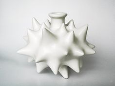 christian escajadillo  Bottle with horns in white matte glaze.
