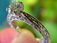 Side view of a Kirk Kara filigree engagement ring in white gold. You can find this at Diana Jewelers in Liverpool, NY. Right outside of Syracuse!