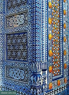 Geometric and floral patterns with repeating eight-pointed star motifs around the doorway of the mausoleum of Sufi poet Sachal Sarmast, Daraza Khairpur, Pakistan - 19th century CE.