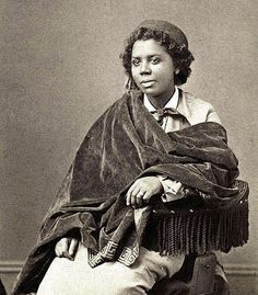 Edmonia Lewis was the first African American artist to earn international fame for her artwork. She earned a living as a sculptor and portraitist and was famous for several of her works, including a bust of Colonel Robert Gould Shaw of which she sold over 100 plaster copies.    Born Mary Edmonia Lewis in 1844 in New York State, Edmonia was actually African American and Native American. Her mother was of Mississauga Ojibwe and African descent, while her father was Haitian of African descent.