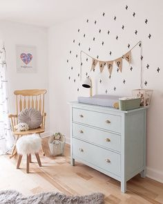"""Our changing table is a wonderful Ikea hack that my husband made for me. We had this old dresser that we were thinking of throwing out, but after a little paint and new hardware, it is so beautiful! It's now one of my favorite parts of the nursery."" —Bowie's mom Erin Barrett (@sunwoven), on breathing new life into old things (More at pnmag.com/babyspace) : @jodymackphotography"