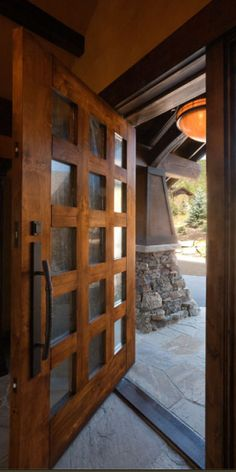 Large Rustic Pivot Entry Door with Bronze Grip and Deadbolt