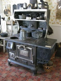 Wood cook stove.  I remember going to visit my Great-Grandmother, who was almost totally blind.  She would cook on her wood stove (like this one) and make the best soup and cornbread you ever tasted.