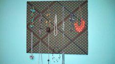Decorative jewelry board. (Plywood, batting, fabric, spray adhesive, ribbon, staple gun, c hooks)