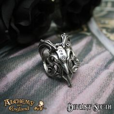 Last Chance! Alchemy Gothic AG-R202 Amon-Ra ring  A polished pewter ring of a stylised ram's skull with clear Swarovski crystals, floriate Baroque horns and set upon a split shank.