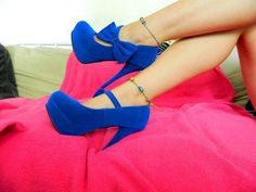 heels  the heels are royal blue color, has a bun on top of the same color of the heels, the heel measures is of  8 cm, we have  size 22  to 27, cost just $ 700.00