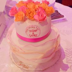Wedding Cakes - 2 Tier Chocolate Wedding Cake with White Fondant and Pink Fondant Ruffles, Scroll Work and Pink and Orange Edible Roses | All Things Yummy  #wedding #cakes #allthingsyummy #roses #fondant #ruffles