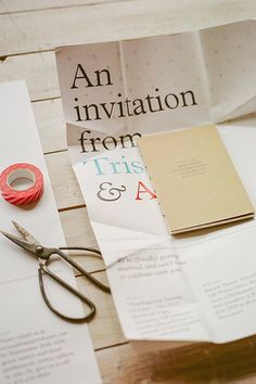 """The oversized invitations were printed locally and folded around a petite """"Greek-Canadian book of cultural observations."""" The color palette was inspired by the two countries — with blue-and-white and red-and-white sprinkled into the design."""