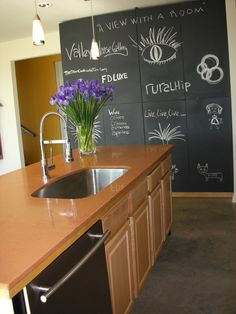 These homeowners saved about $10,000 on their countertops by going with a less expensive alternative to granite -- an Italian-manufactured product called Okite. Made from ground quartz, it's a sustainable material that comes in 90 colors. The pantry doors are made of inexpensive plywood covered in chalkboard paint.