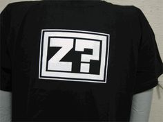 Z?  Question Sleep. It is something of a mantra to some people, carrying its own personal meaning. This design by Jhonen Vasquez is actually the logo that is found on the hardcover version of Johnny the Homicidal Maniac Director's Cut.  Printed on a nice, soft, 100% cotton Hanes nano (for men) or Bella (for the ladies) Z? is hand printed by t-shirt printing savants right here in the SLG office and is a must-have for all Jhonen Vasquez fans.