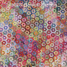 Wow, gorgeous! Flower garden quilt