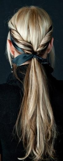 This is a pretty standard rolled ponytail, but a ribbon headband threaded under and then tied around jazzes it up a little (and we could all use a little jazz).