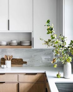 modern farmhouse kitchen with gray cabinets and bleached oak cabinets, marble counter top