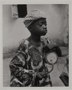 Young Yoruba drummer, who led a group of his friends performing on dundun drums at the Mbari Mbayo Club in Osogbo, 1964 by Ulli Beier Yoruba, African Culture, Drummers, Pots, Dancer, Instruments, Creativity, Journey, Portraits