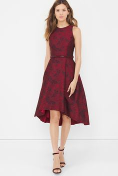 A look from our Inauguration Collection. A floral jacquard dress in a dramatic red is a quintessential party must-have. The high-low hem is right on trend and gives a flirty finish when paired with our red encrusted skinny belt and red chunky heels. White House Black Market | Holiday Party Style