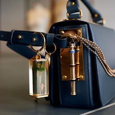 Sophie Hulme's personal collection of charms, clipped to her charcoal Finsbury. The minimal Finsbury is the perfect canvas for personalisation. Winter Wardrobe Essentials, Sophie Hulme, Leather Shoulder Bag, Shoulder Bags, Midnight Blue, Leather Fashion, Winter Fashion, Aqua, Crossbody Bag