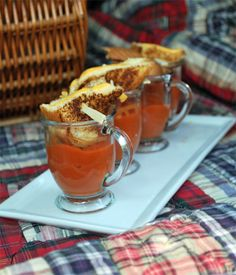 tomato soup and grilled cheese sandwiches partnered together in a small mug
