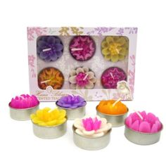 Bright and colourful floral tea lights new for spring / summer 2014.  These floral tea lights remind us of the lotus flower which is a popular flower used in Asian designs.  We thought these beautiful tea lights would be stunning for Asian weddings, hen celebrations and mehndi parties.  These would also make great gifts or wedding favours by www.fuschiadesigns.co.uk - £7.99 per box of 6.