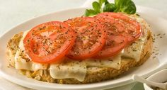 Jazz up a grilled cheese sandwich by serving it open-faced with sliced tomatoes and a sprinkling of oregano.