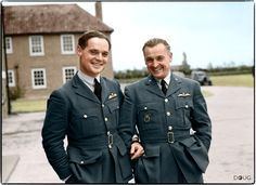 C: Squadron Leader Douglas Bader, commanding No. 242 (Canadian) Squadron, with Major Alexander 'Sasha' Hess, CO of No. 310 (Czechoslovak) Squadron, outside the Officers Mess building, Duxford, Cambridgeshire. October 1940.
