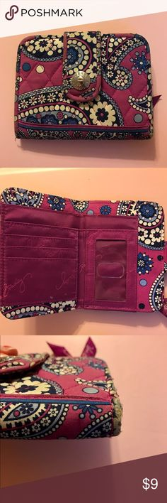 Vera Bradley Wallet This Vera Bradley wristlet is in the color boysenberry. The wallet has a change compartment, ID slot, 4 card compartments and a cash pocket. The wallet is worn on the two bottom corners as shown in the picture and there is a small bit of tarnish on the magnetic clasp on the outside. Overall, the wallet is still in good condition. Vera Bradley Bags Wallets