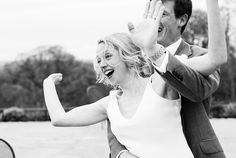 Fun, dancing Elaine Kennedy bride with groom at a lively Surrey Wedding © Fiona Kelly Photography