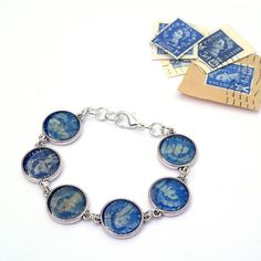 Postage Stamp Bracelet - great way to get rid off that old stamp collection Stamped Jewelry, Resin Jewelry, Jewelry Crafts, Jewelry Art, Beaded Jewelry, Handmade Jewelry, Resin Crafts, Jewlery, Resin Bracelet