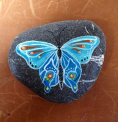 Butterfly rock that is beautifully painted!!..The artist is Syd George.