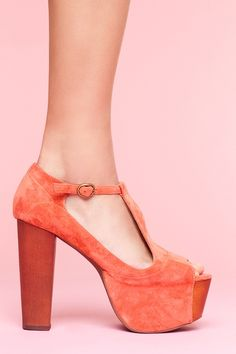 Foxy Platform-Coral Suede: Sky high coral suede T-strap platform sandals featuring a peep toe and chunky wooden heel. Partially covered wooden platform, genuine leather interior. Perfect paired with a floral dress and cat-eye sunnies! By Jeffrey Campbell.