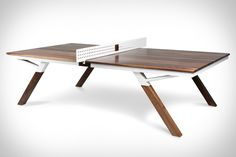 If you think a ping pong table belongs in the basement or garage, you'll think again after one look at the Woolsey Ping Pong Table. It can sit comfortably next to your other furniture or class up a rec room...