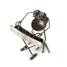 Perfect for a pencil pusher who loves to rock, these salvaged metal sculptures bring street cred to your desktop