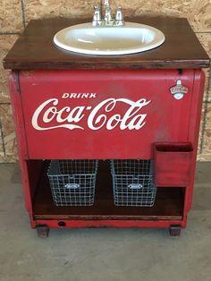 Vintage Coca Cola cooler repurposed into bathroom vanity
