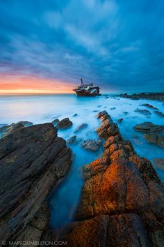The wreck of the Meisho Maru 38 which ran aground between Suiderstrand and Cape Agulhas on 16 November captured on a December evening after sunset. A long exposure with the sun below the horizon created ethereal effects of light on the foreground rocks. Great Places, Beautiful Places, Abandoned Train Station, Provinces Of South Africa, What A Wonderful World, Countries Of The World, Science Nature, Wonders Of The World, Travel Inspiration