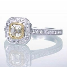 Yellow Diamond ASSCHER cut Engagement Wedding Ring by SAMnSUE, $2280.00. Gold halo interesting, maybe rose.