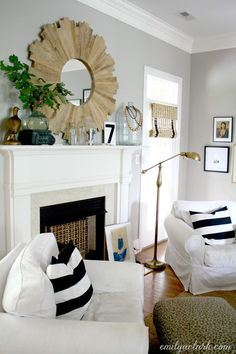 Accessorizing Our Living Room For Fall, seasonal decorating, neutral, black white stripes, mantel, wood sunburst mirror, gray walls