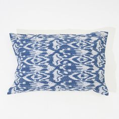 Beautiful handmade blue Ikat design cushion or pillow cover. Each pillow is created from a soft organic cotton, screen printed, and then hand stitched.