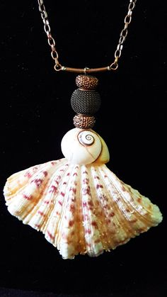 This pendant necklace features a Red Cardita shell and Sea Snail.  Note the incredible texture and delicate detailed colors of the Cardita. The