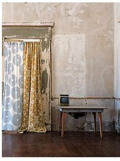 Cover a doorway or closet with mismatched curtains.