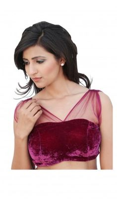 A Bustier Shaped velvet Saree Blouse Designs with Deep net back with net shoulders and a knot. For more detail visit http://www.kbshonline.com/
