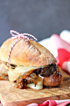 Steak Sandwiches with Caramelized Onions and Provolone Cheese from http://cravingsofalunatic.com- This easy recipe will be a hit with everyone who tries it. Grilled steak, caramelized onions, provolone cheese, all stacked perfectly on a French baguette. Take a bite!