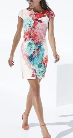 This figure-flattering, cap-sleeve sheath dress features large colored blooms that are perfect for spring! It's also cut from stretchy scuba fabric and topped with an elegant bateau neckline.