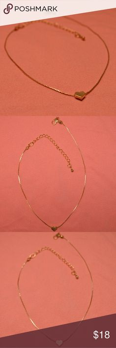 """Tiny Gold Heart Charm Choker Necklace New NWT Adorable tiny gold heart choker. Dainty, girly piece in classic gold color. Comes on a stylish thin gold chain. Great for a boho bohemian hippy look if layered with other chokers or super cute on its own. This listing is for the heart choker only. Shown layered with other necklaces available in my closet.  Brand new. Adjustable from 12-15"""".  Bundle to save on shipping. Similar in style to Stella and Dot. Used for exposure only. Stella & Dot…"""