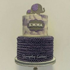 """Purple, gray and white baby shower cake with elephants, """"watercolor"""" top tier and buttercream ruffles. https://m.facebook.com/simplycakes.brittneyshiley/"""
