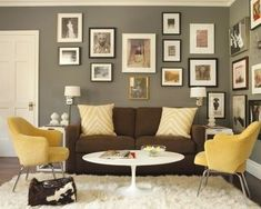 Grey walls, brown couch, black frames with pop of color and lots of white not feeling that mustard yellow accent color but like the general idea