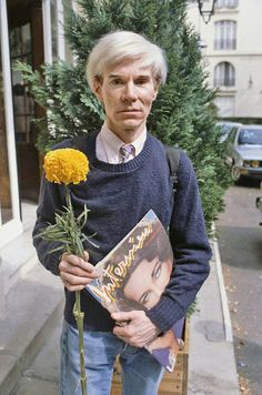 Andy with flowers. Is this real? Fantasy dream world complete.