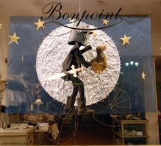 This french store display window is beautiful. I love the moon.