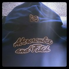 Dark Blue Abercrombie Hoodie Perfect condition. Very heavy and well made. Dark blue and brown/tan lettering. Marked large but does run small. Abercrombie & Fitch Tops Sweatshirts & Hoodies