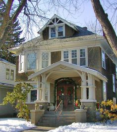 american+foursquare+modernized+front+doors   Sided in stucco, this Foursquare house has elaborate Craftsman ...