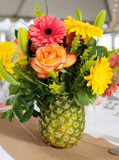 pineapple vase for a luau Hawaiian Luau Party, Hawaiian Theme, Tropical Party, Tropical Decor, Tropical Floral Arrangements, Hawaiian Wedding Flowers, Summer Flower Arrangements, Luau Theme Party, Aloha Party